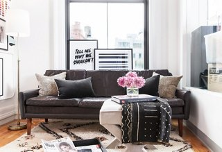 Atop A Plush Moroccan Rug, A Midcentury Leather Sofa Acts As A Relaxed, No
