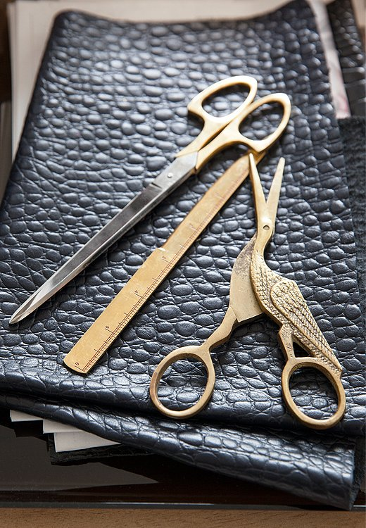 Black and brass are always a winning combo, especially when it's supple leather against vintage scissors.