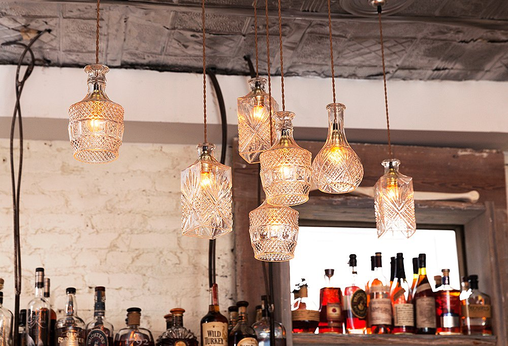 A genius light fixture, created from vintage crystal decanters.