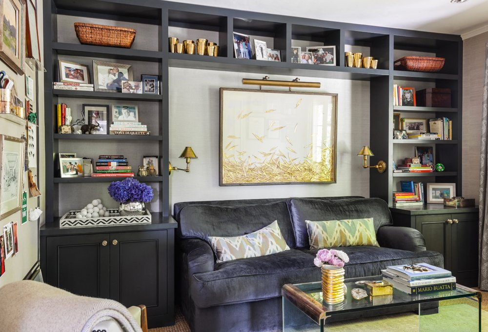 Just as fashionistas swear by tailoring, if you can't find furnishings that are the right size for your space, get them made! In Susan's case, this meant a custom bookshelf and a blue-velvet couch crafted to fit in the nook.