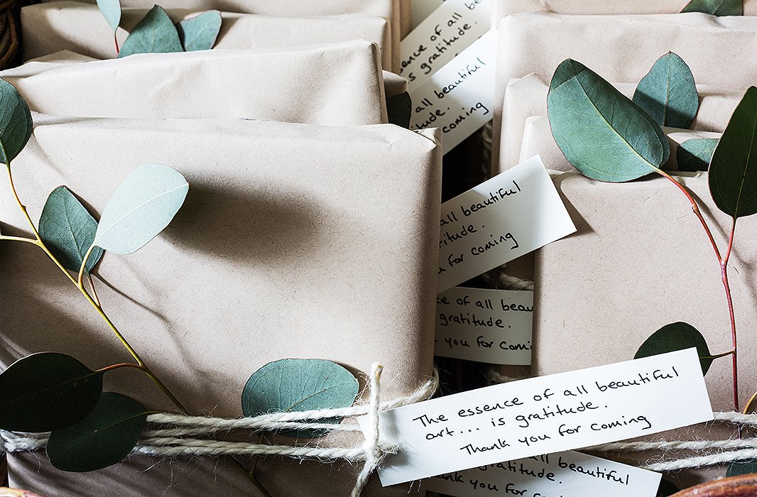 The framed artwork favors were wrapped in kraft paper, tied with twine, and embellished with fragrant eucalyptus. A handwritten note made the gift feel truly thoughtful.