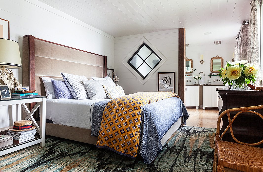 An orange duvet adds an unexpected pop of color and a slightly exotic feel to the master bedroom.