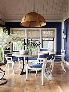 The Walls Of The Dining Room And The Dining Chairs Are Upholstered In The  Same Rich