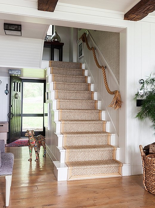 Thom removed the banister to make the entryway feel more open. The rope hung in its place adds whimsy and rugged texture.