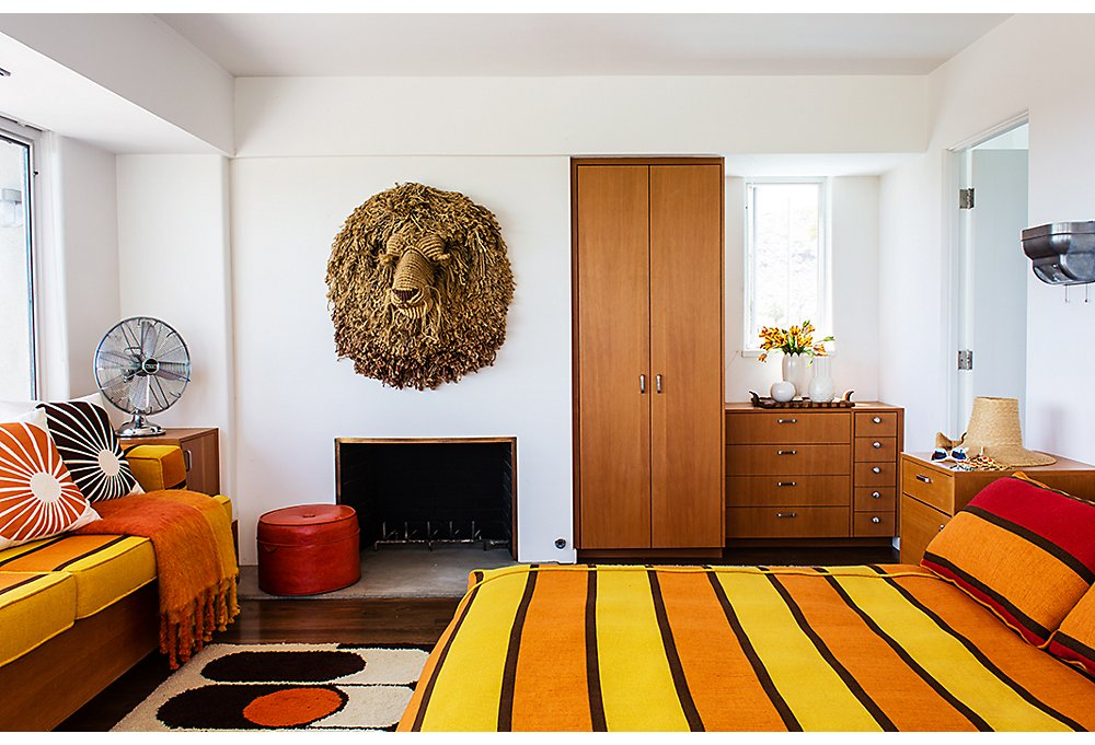 """We give the master suite to friends and family so that they can enjoy the great view… and the lion,"" says Trina. (It's one of three macramé animal heads by artist Judee du Bourdieu.) ""We're kind of obsessed."""