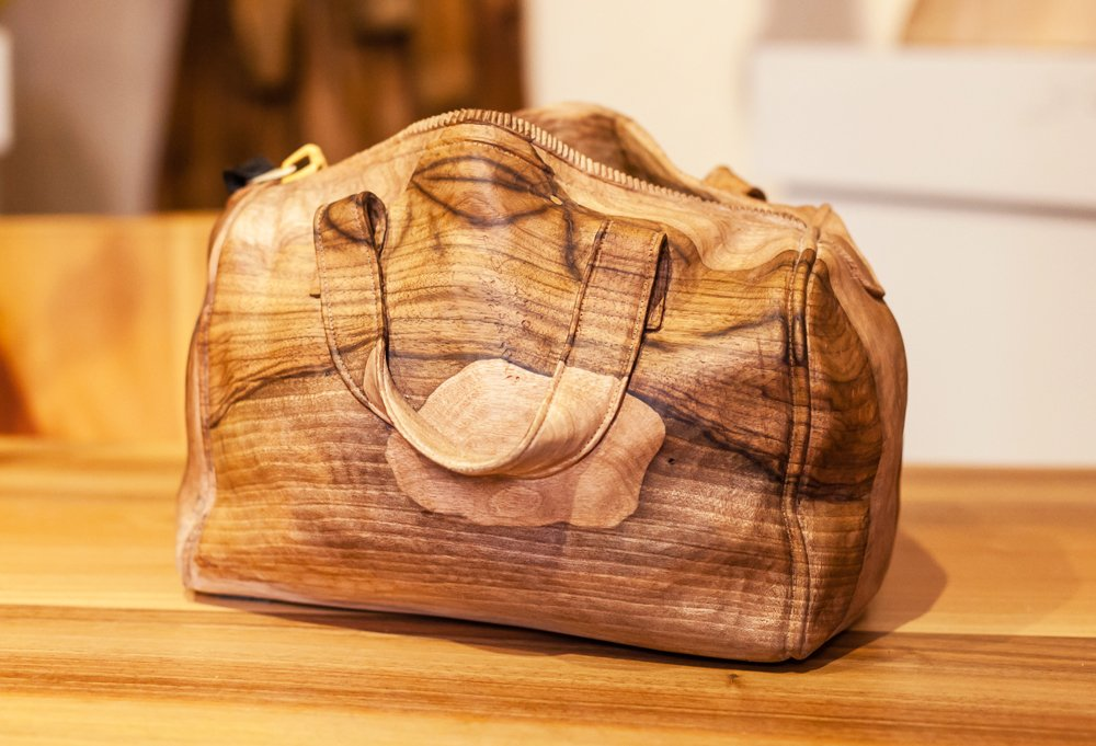 This purse was handmade entirely from wood by Venice-born master carver Livio De Marchi.