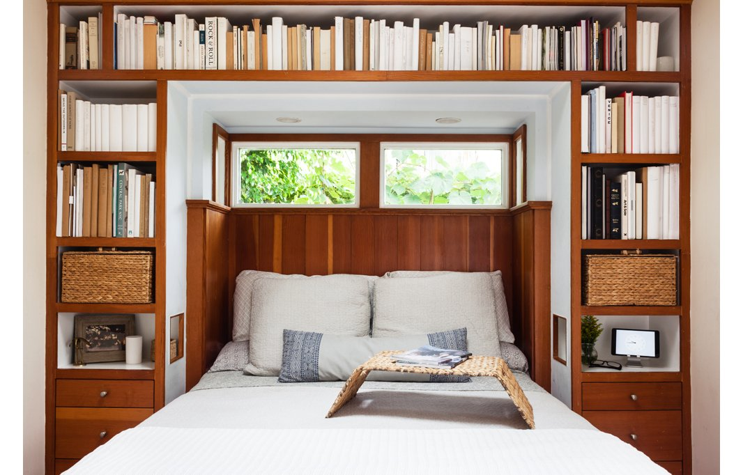 The built-in bookshelves in the bedroom were a huge selling point for Morris. If you look closely, you'll spot cutouts between bed and nightstand that Morris calls genius for the easy access they give to a book or a glass of water.