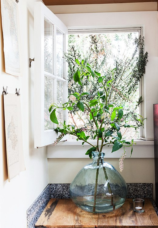 Amixof tree branches—any variety with smaller leaves will do—adds an easy rustic accent to any space.Photo by Nicole LaMotte.