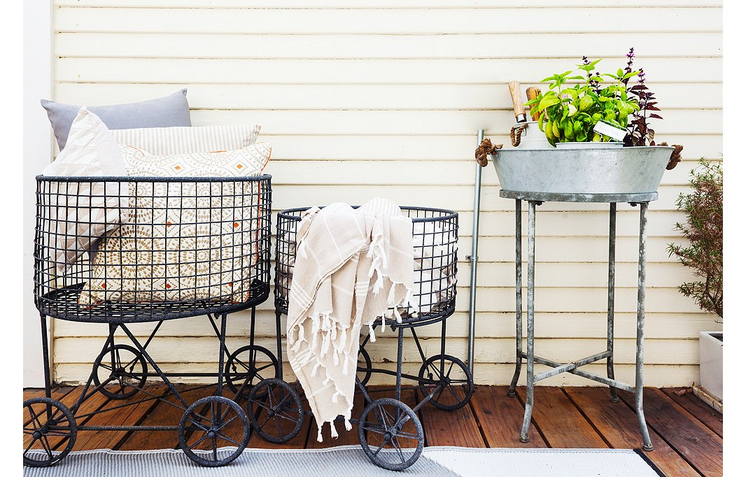 These laundry baskets are used to hold pillows and throws so that guests can get comfortable on the porch.