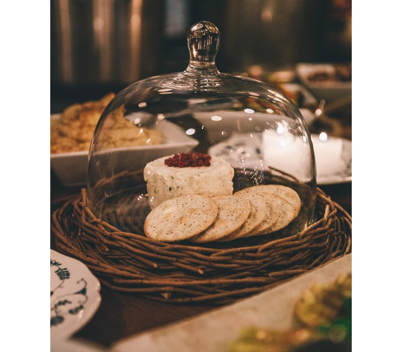 A glass cloche with a woven wicker border held even more fromage.