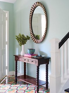 A Large Oval Mirror Manages Not To Overpower The Petite Console In This  Entryway. Photo