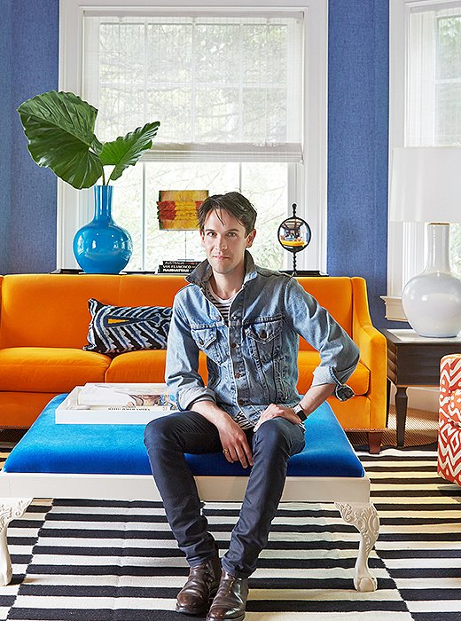 The color master himself, Patrick Mele, in the home's colorful living room.