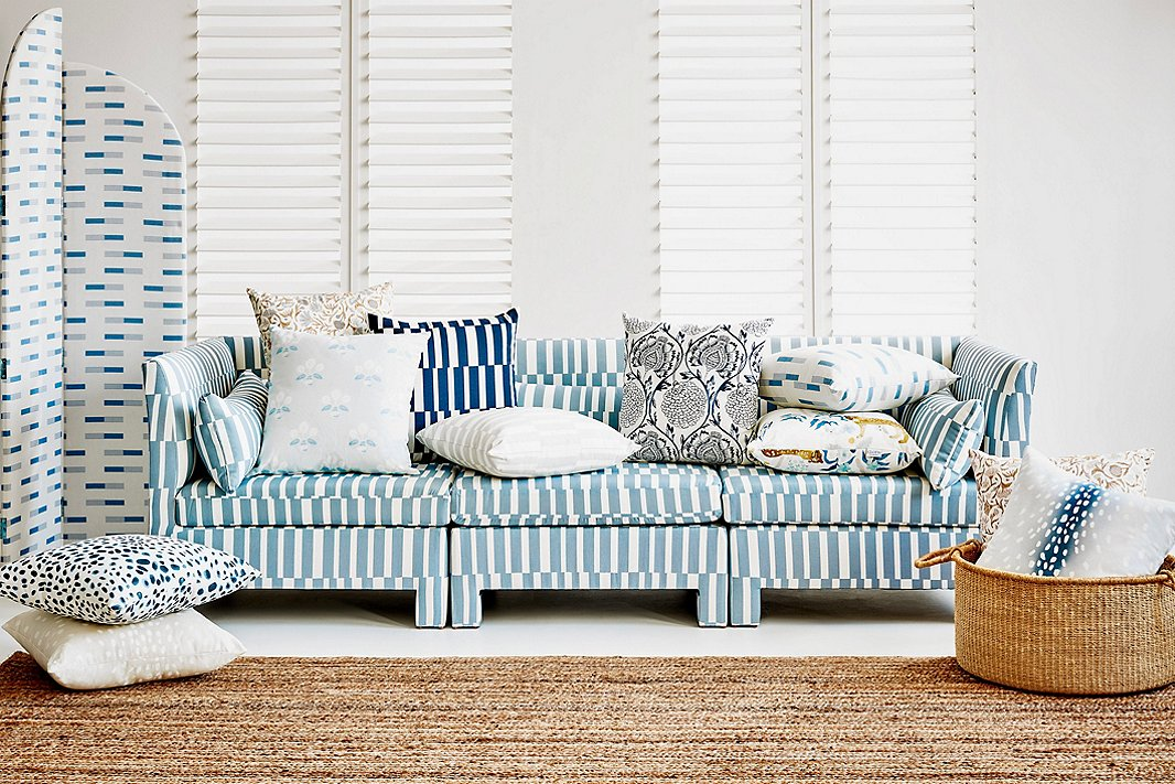 Blues and whites add cohesiveness to this mélange of patterns. Complementing the Sidney Room Screen in Hugh Chambray and the Bryn Sofa in Essie Stripe Chambray, both of which are One Kings Lane exclusives, are a variety of exclusive pillows.