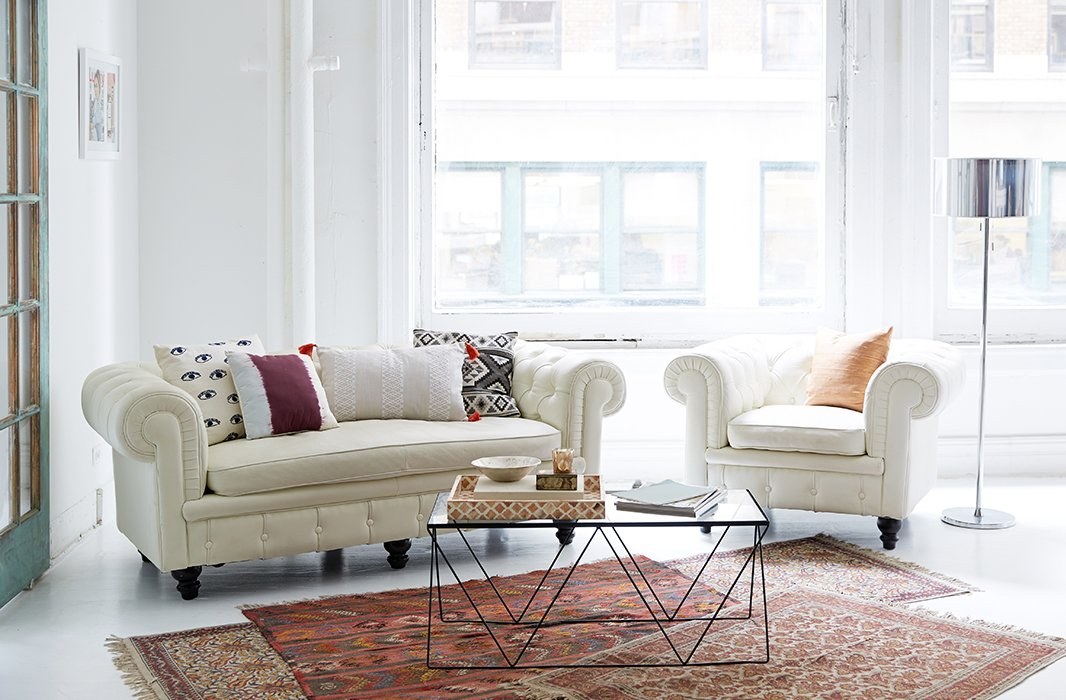 """""""We come from a really hippie, spiritual town, but we also live and work in the city, soour space is a nice blend,"""" says Danielle of their NYC office, which combines a classic chesterfield with boho touches such asMoroccan rugs."""