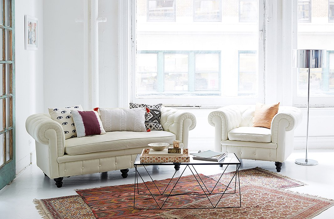 """We come from a really hippie, spiritual town, but we also live and work in the city, so our space is a nice blend,"" says Danielle of their NYC office, which combines a classic chesterfield with boho touches such as Moroccan rugs."