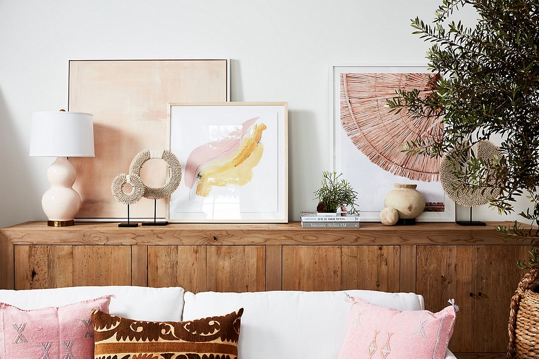 The Annia is a six-door version of the above sideboard. Also shown above: cowry shell necklaces on stands; Breath I by Rebecca Stern (center); and Mykonos Umbrellas by Natalie Obradovich.