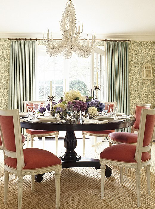 Designer Ashley Whittaker used a practical sisal carpet with an eye-catching diamond pattern to ground this dining space but not compete with the standout wallpaper and dining chairs. Photo by Eric Piasecki.