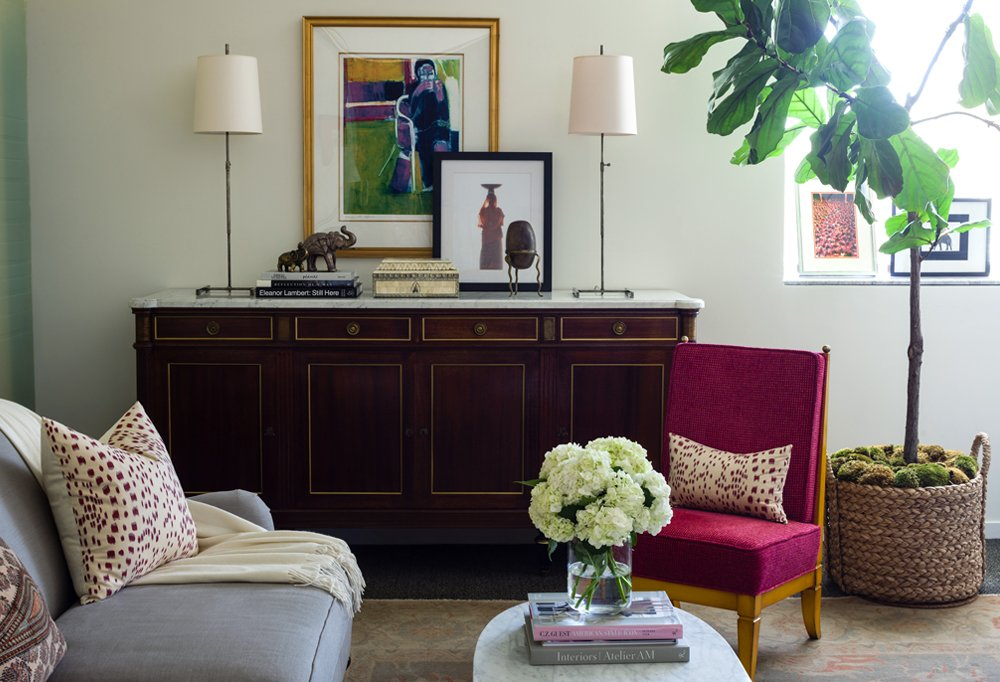 The credenza and the slipper chair were both discovered among One Kings Lane's vintage offerings, while the pair of lamps are by Visual Comfort.