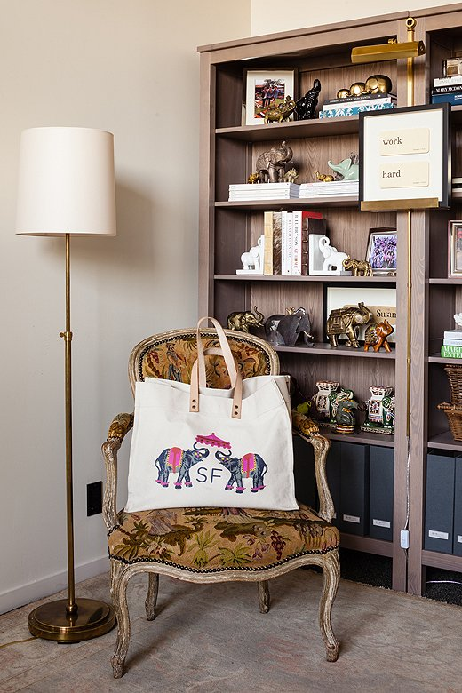 On the chair that inspired Susan's design scheme is a bag gifted to her by the brand iomoi, featuring elephants and her initials.