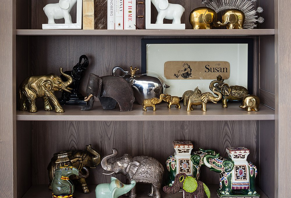 Susan's impressive collection of elephants on display in her office bookcase.