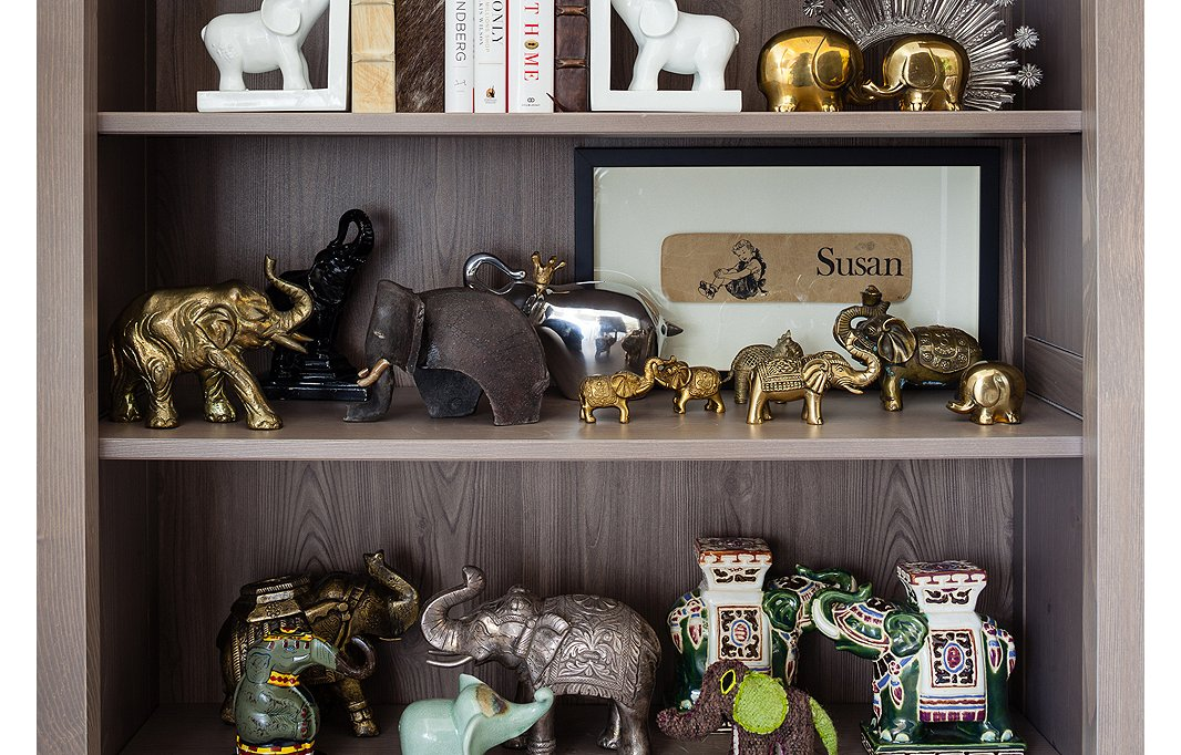 One Kings Lane co-founder Susan Feldman collects elephants. On her shelves figurines old and new, from all around the world, cavort together in one happy, harmonious herd.