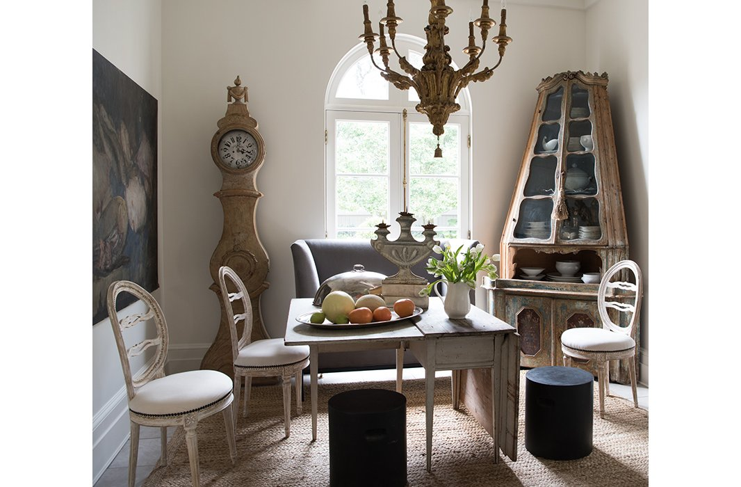 Timeless French Decorating Ideas {Tara Shaw}. An 18th-century Venetian corner cabinet, a 19th-century Belgian still life, and a Swedish drop-leaf table make the breakfast room feel as if it has been lifted out of an earlier century - yet Tara has balanced the pieceswith dining room chairs and a gray banquette from Tara Shaw Maison.