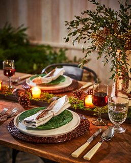 Tones Of Green And Brown, Along With A Candlelit Moss And Pinecone  Centerpiece