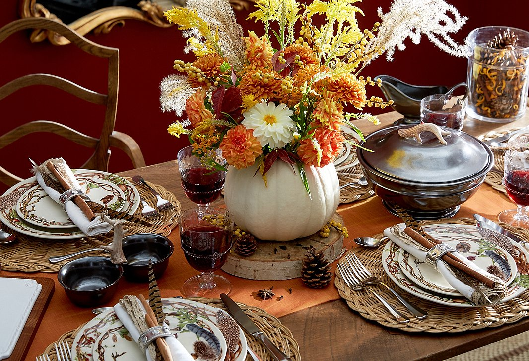 With its whimsical woodland motifs, Juliska's Forest Walk dinnerware feels right at home on the Thanksgiving table. Hollow out a white pumpkin and place a floral arrangement inside for a finishing flourish.