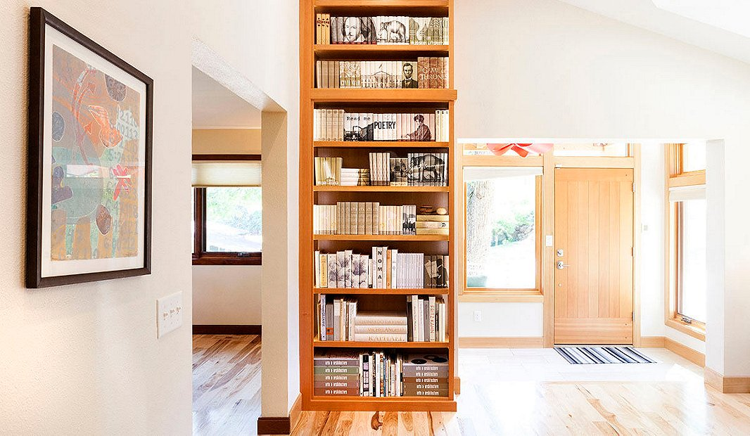 A towering shelf in Thatcher's own home features dozens of sets from Juniper Books.