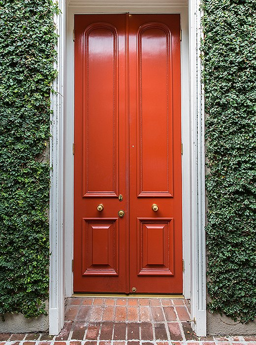 The front entrance to the atelieris fittingly a grand, lipstick red door.