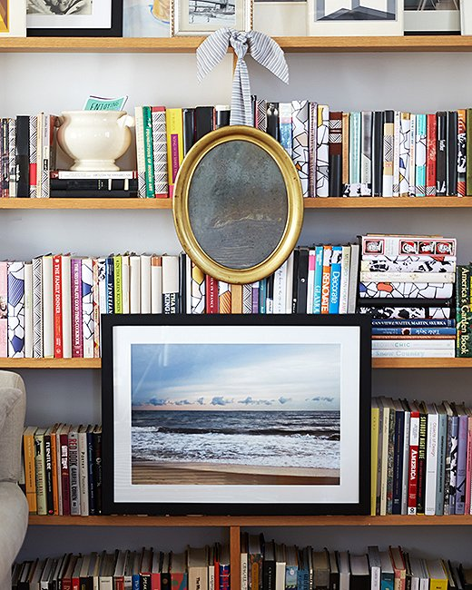 """Don't forget about the outside of the bookshelf as well,"" Becca says. ""It's a classic look to hang art on the outside of the bookshelf."" Photo by Manuel Rodriguez."
